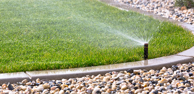 Image of sprinkler watering a lawn